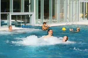 Alpenbad Leutasch fun and relaxation in the warm outdoor pool in summer
